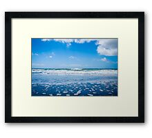 Ocean waves and blue sky with clouds Framed Print
