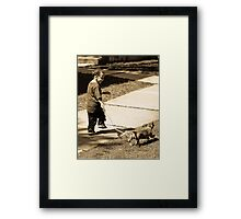 A boy and his dog Framed Print