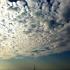 Clouds & waves by Jean-Luc Rollier