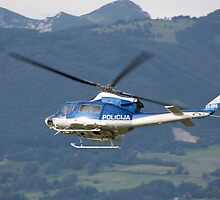 Police helicopter patrolling by Ian Middleton