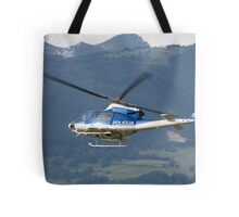 Police helicopter patrolling Tote Bag