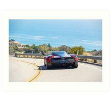 Red Pagani Huayra driving through the Malibu Hills Art Print