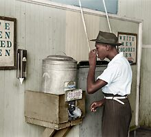 """1939 July: Man drinking at """"Colored"""" water cooler in streetcar terminal, Oklahoma by Marie-Lou Chatel"""