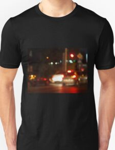 Blur and defocused lights on the stream of cars Unisex T-Shirt