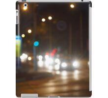 Defocused lights on the stream of cars and traffic lights iPad Case/Skin