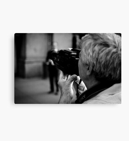 Old camera man Canvas Print