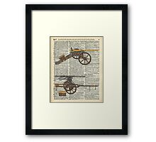 Old military cannons over dictionary book page Framed Print