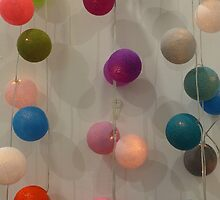 Coloured light balls and gentle shadows  by Anna Myerscough
