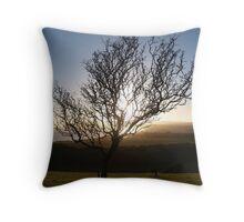 The sun setting behind tree Throw Pillow