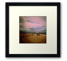 Couple on a pier Framed Print