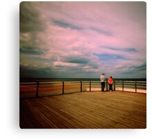 Couple on a pier Canvas Print