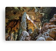 Stalagmite towers over caver, Thailand Canvas Print