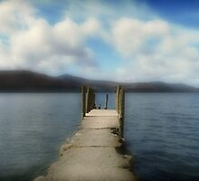 Pier into the lake. Lake District. by Andrew Briffett