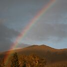 Rainbow on the San Francisco Mountain Peaks. by mikepemberton