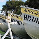 Boats for hire  -  Greenwell Point, NSW. by Lunaria