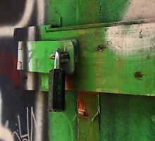 lock painted with green graffiti by metalhund