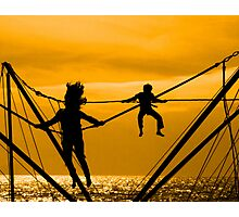 Boy and girl jump Photographic Print
