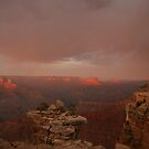Sunset and rainbow in the Grand Canyon. by mikepemberton