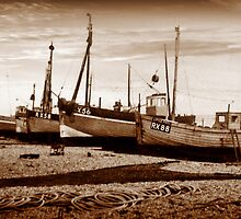 Fishing Boats on pebble beach by frank lee