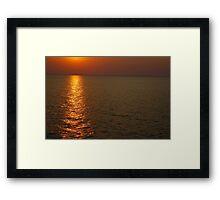Beautifull sunset in sea Framed Print