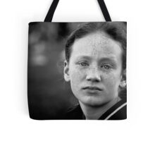 Another day, another eldest sibling worn down by her numerous brothers and sisters and wishing (if only for a day or two) she were an only child Tote Bag