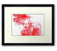 Red Ink spreading through water Framed Print