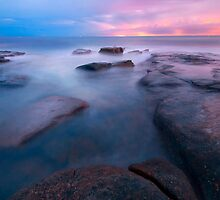 Rocks and waves at Kings Beach, Queensland by Rob D