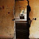 Doorways of S-21, Phnom Penh, Cambodia. by Hayley Joyce