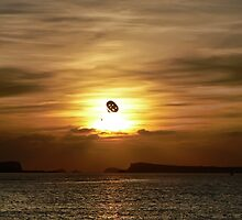 Parasailing at sunset by Sam Smith