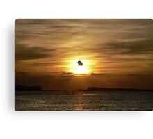 Parasailing at sunset Canvas Print