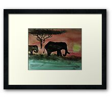 Elephants in a sunset, watercolor Framed Print