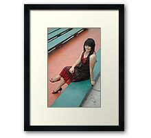 young lady wearing black and red gown Framed Print