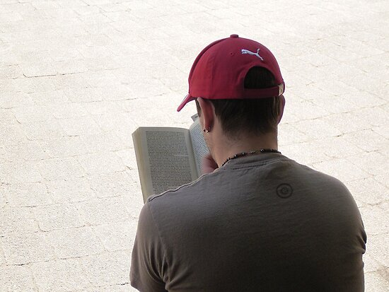 Young man intently reading  - Hyde Park Sydney 2005 by sbyrne
