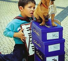 Boy, Dog and Accordian by John Butler