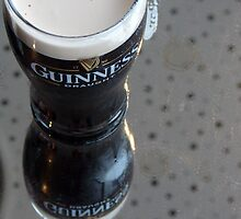 guiness glass of beer reflection by milena boeva