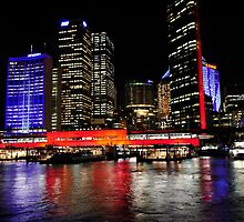 Circular Quay under lights - Sydney's Ferry Terminal. by Alwyn Simple