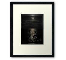 Moon over open Water Framed Print