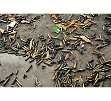Spent cartridge shells on ground in Vietnam Photographic Print