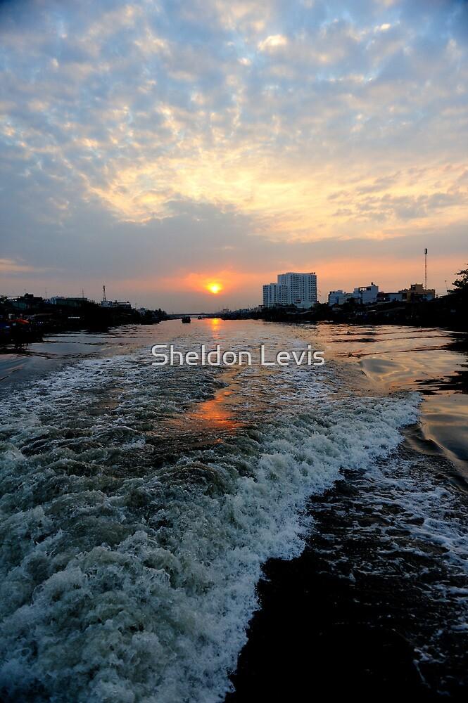 Sunrise over the Saigon River by Sheldon Levis