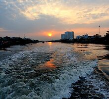 Sunrise over the Saigon River by Sheldon Levis