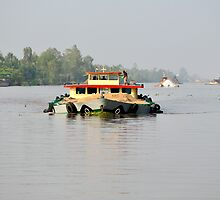 Heavily overloaded boat on Mekong River, Vietnam by Sheldon Levis