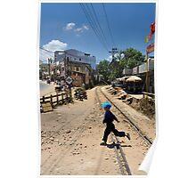 Child jumping railway tracks. Trai Mat, Da Lat (Dalat), Vietnam Poster