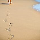 Footprints in the sand by Tom Anderson
