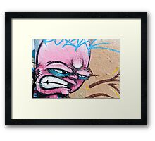Angry Face Graffiti on a textured Wall Framed Print