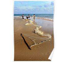 Fishermen emptying their net on the beach. Mui Ne, Vietnam Poster