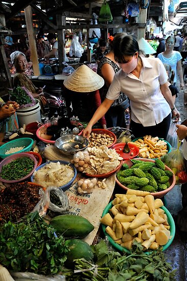 Woman shopping at fresh vegetable market. Vung Tau, Vietnam by Sheldon Levis