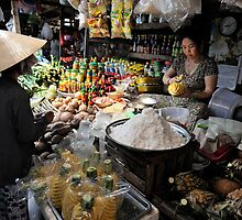Woman at food stall preparing fresh pineapple. Vung Tau, Vietnam by Sheldon Levis