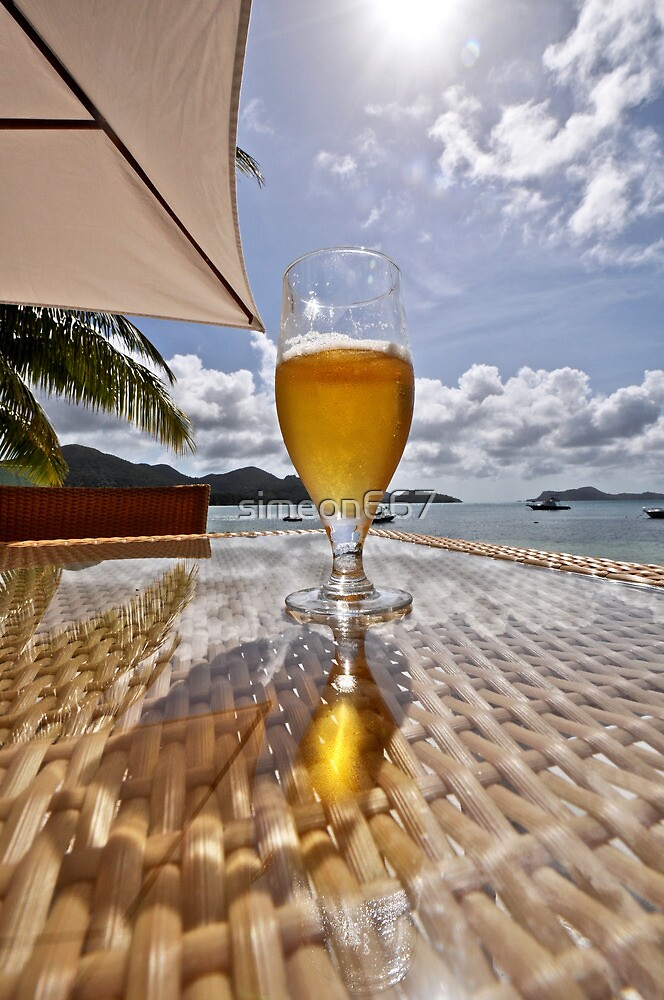 Glass of Beer on a Beach Table by simeon667