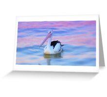 Pelican paddling at sunset Greeting Card