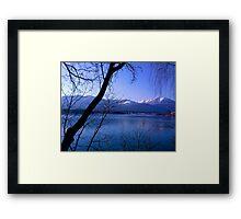 Lake in Austria, framed by trees Framed Print